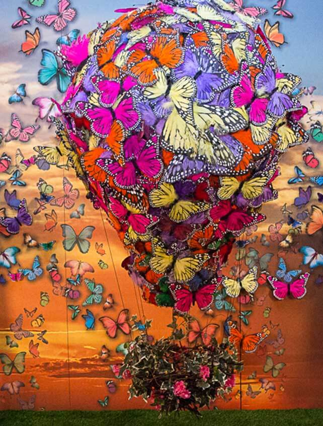 A fabricated sculpture of a hot air ballon composed of butterflies.