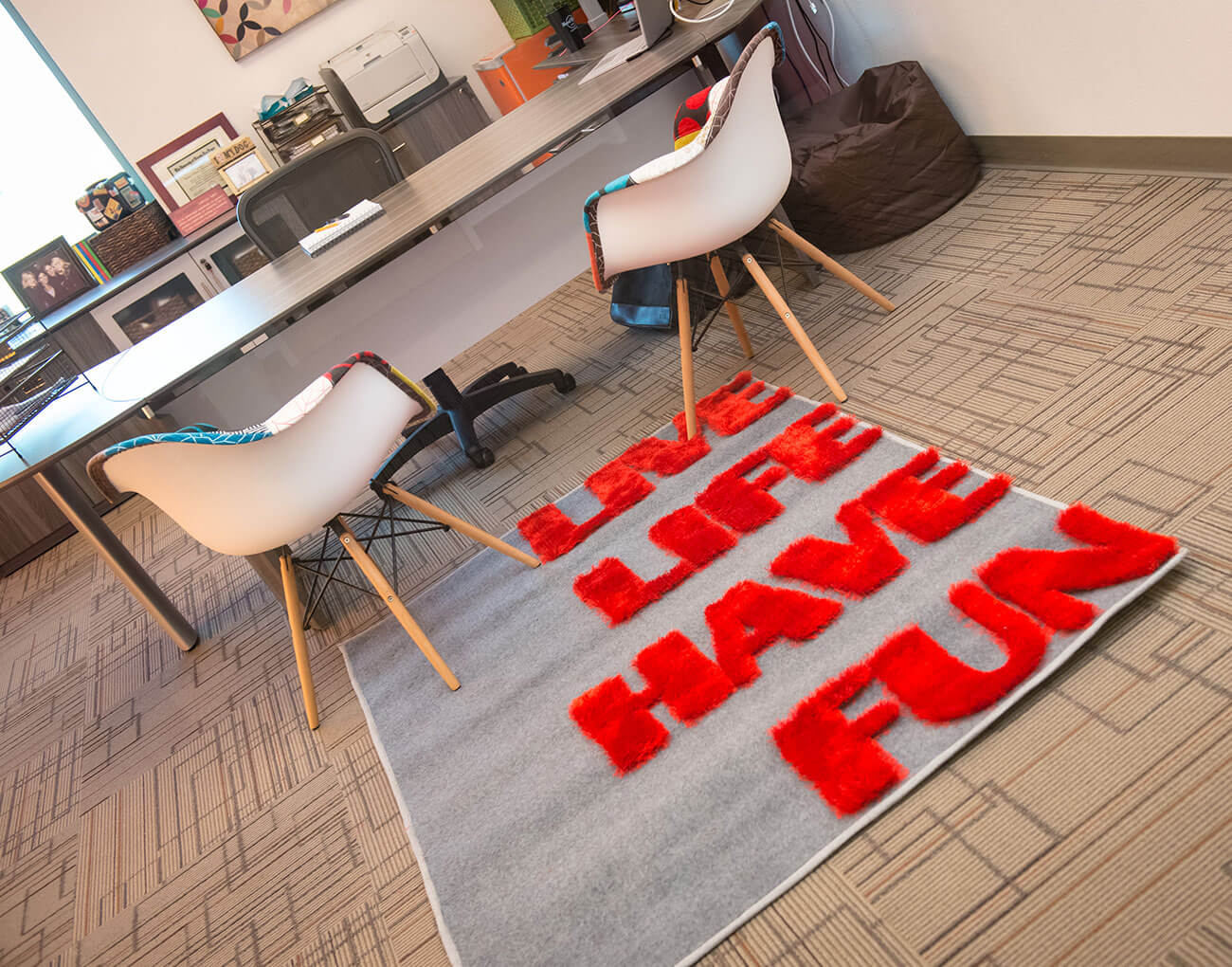 An office space with a rug that says