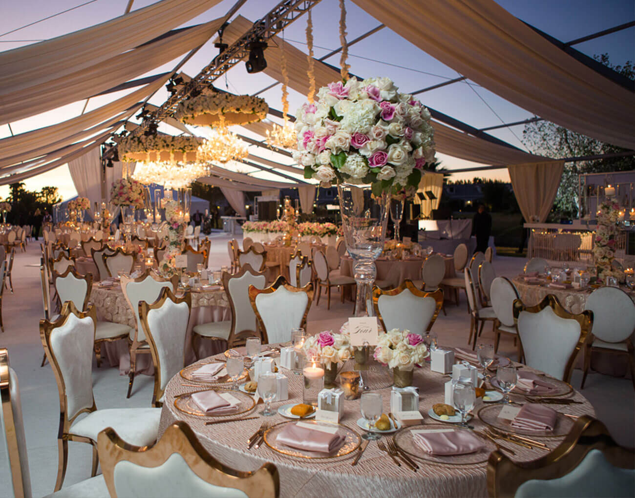 Reception under an outdoor marquee