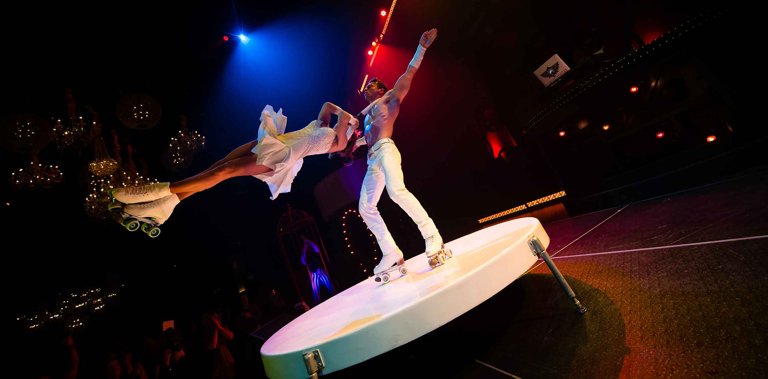 Acrobats in roller skates swinging around a stage