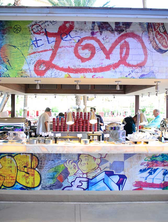 Outdoor food station with street art decor