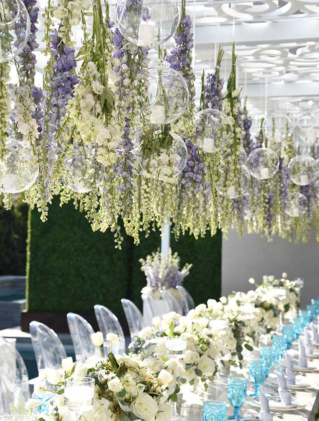 Flowers suspended over the table at an outdoor baby shower