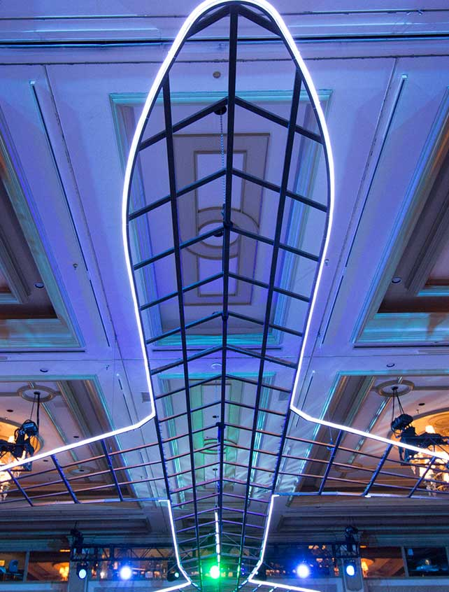 Neon airplane suspended from the ceiling