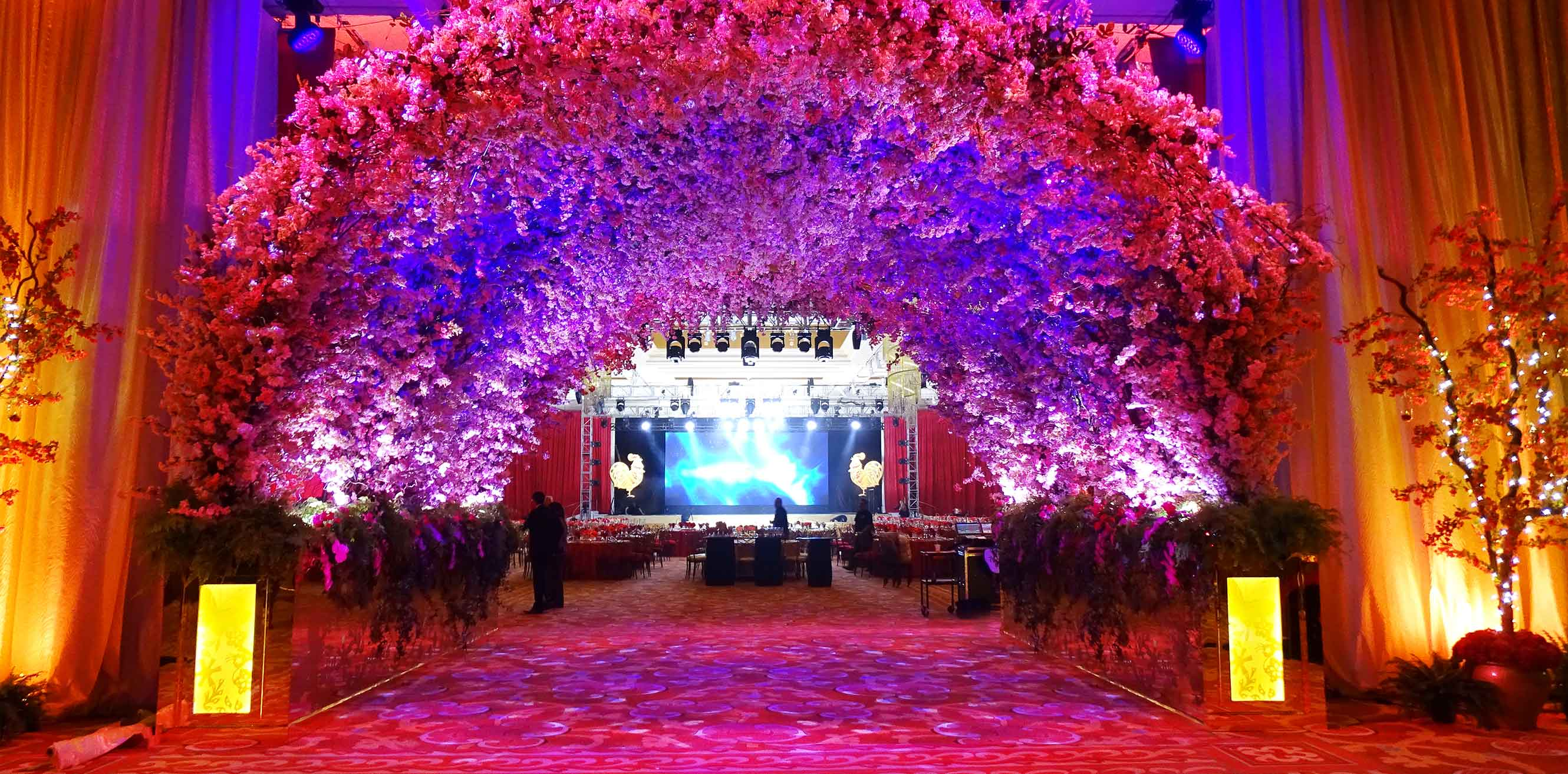Floral arrangements forming a series of arches