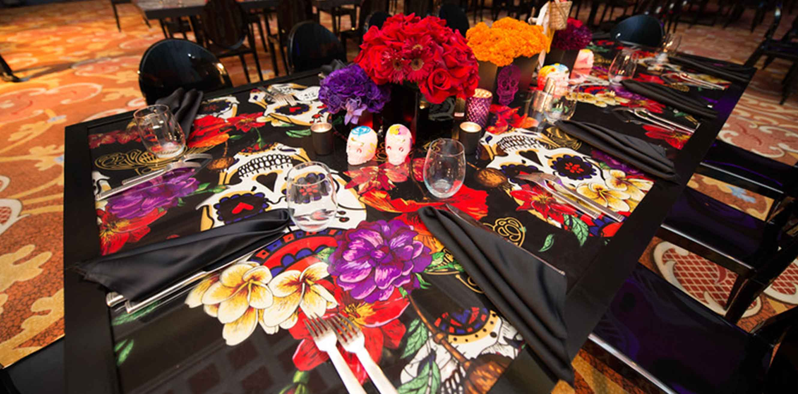 Screen printed skulls on place settings for Dia de los Muertos