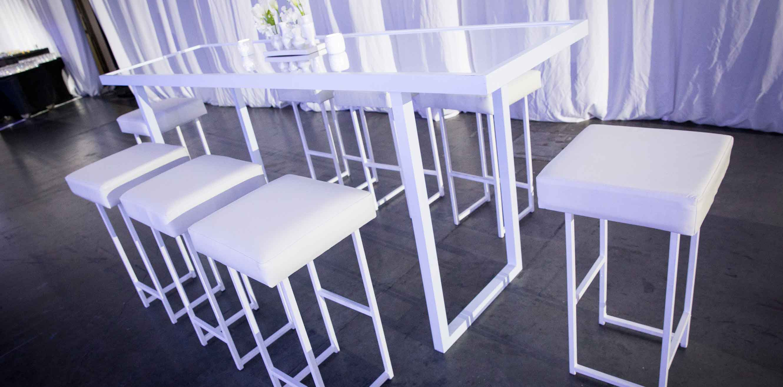White stools and matching table