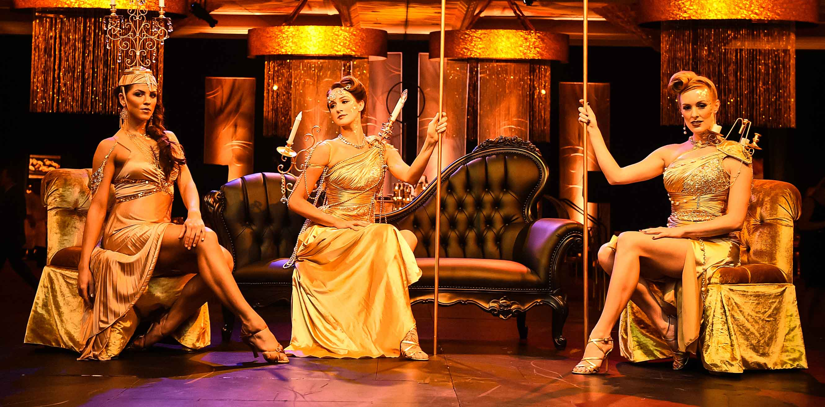 Women in gold costumes at an event
