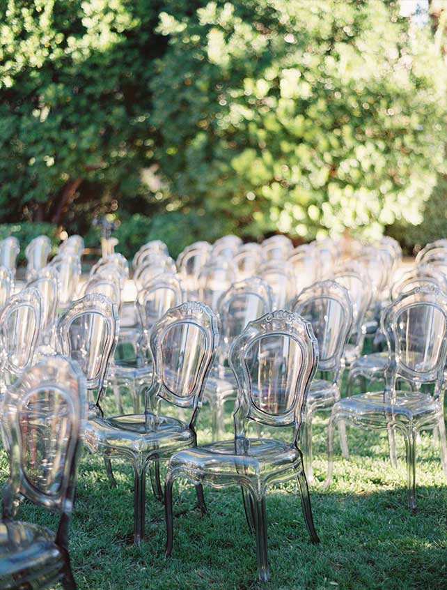 Rows of clear chairs on grass