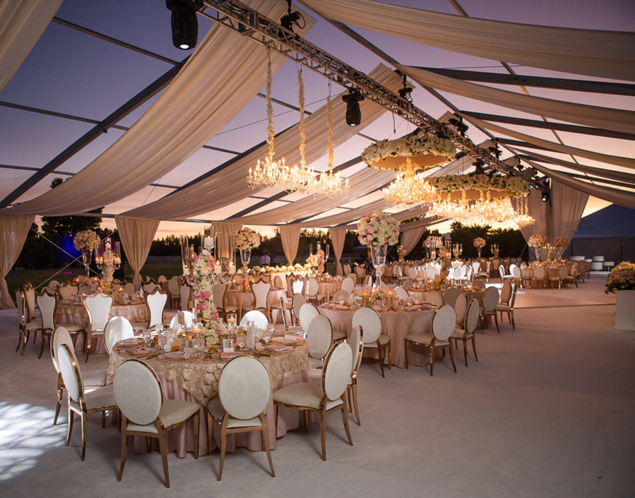 Inside a wedding marquee at dusk