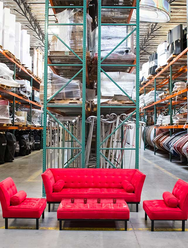 Sofa and chairs set up in a warehouse