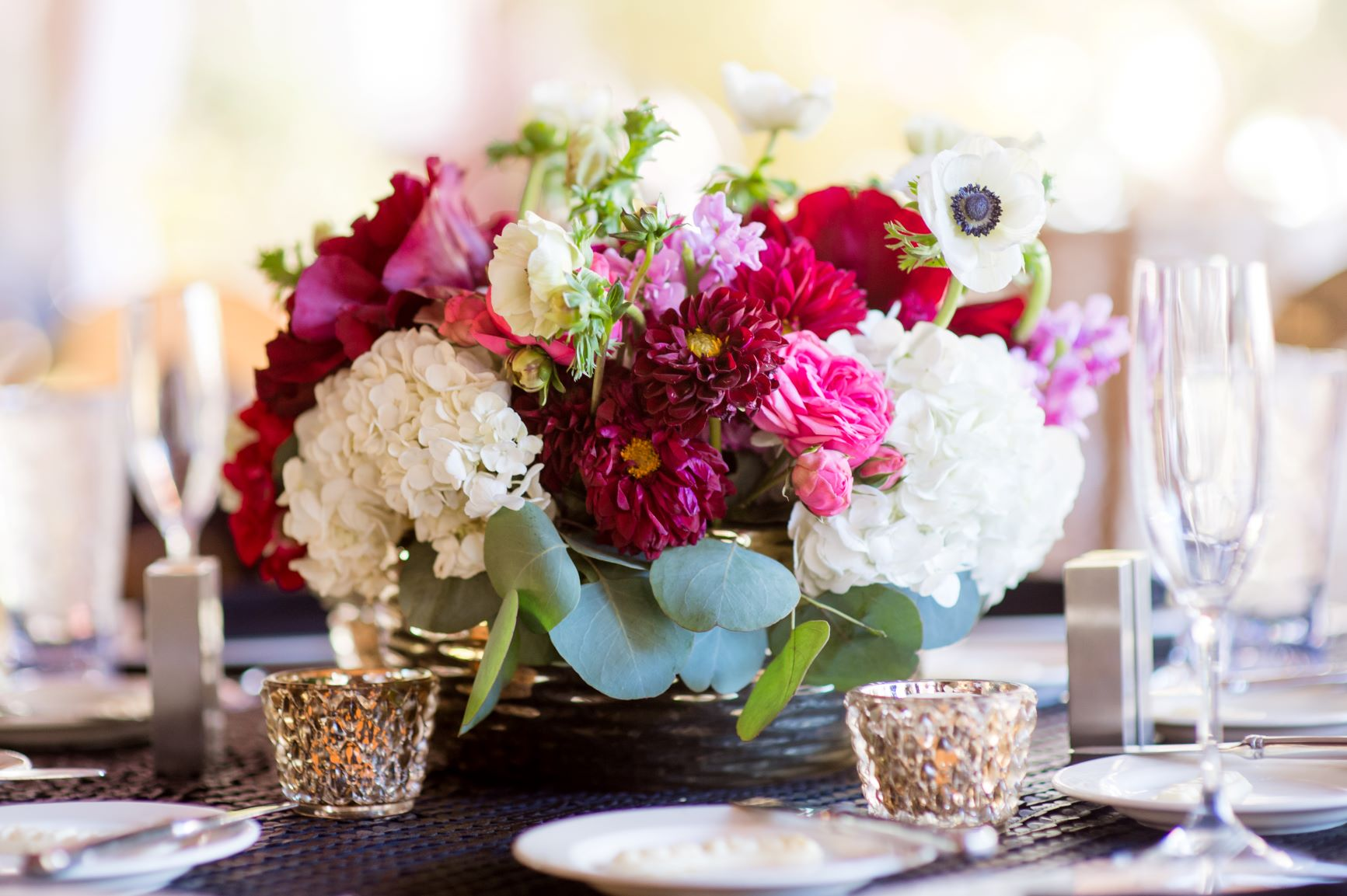 Centerpiece with white and maroon flowers