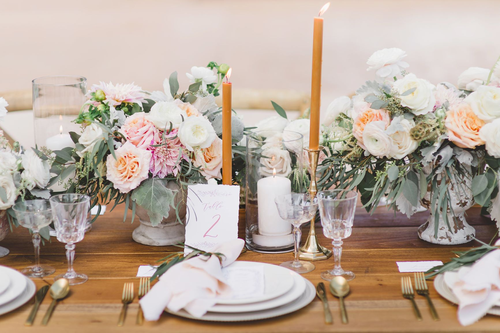 Centerpieces with peach, white and pink flowers