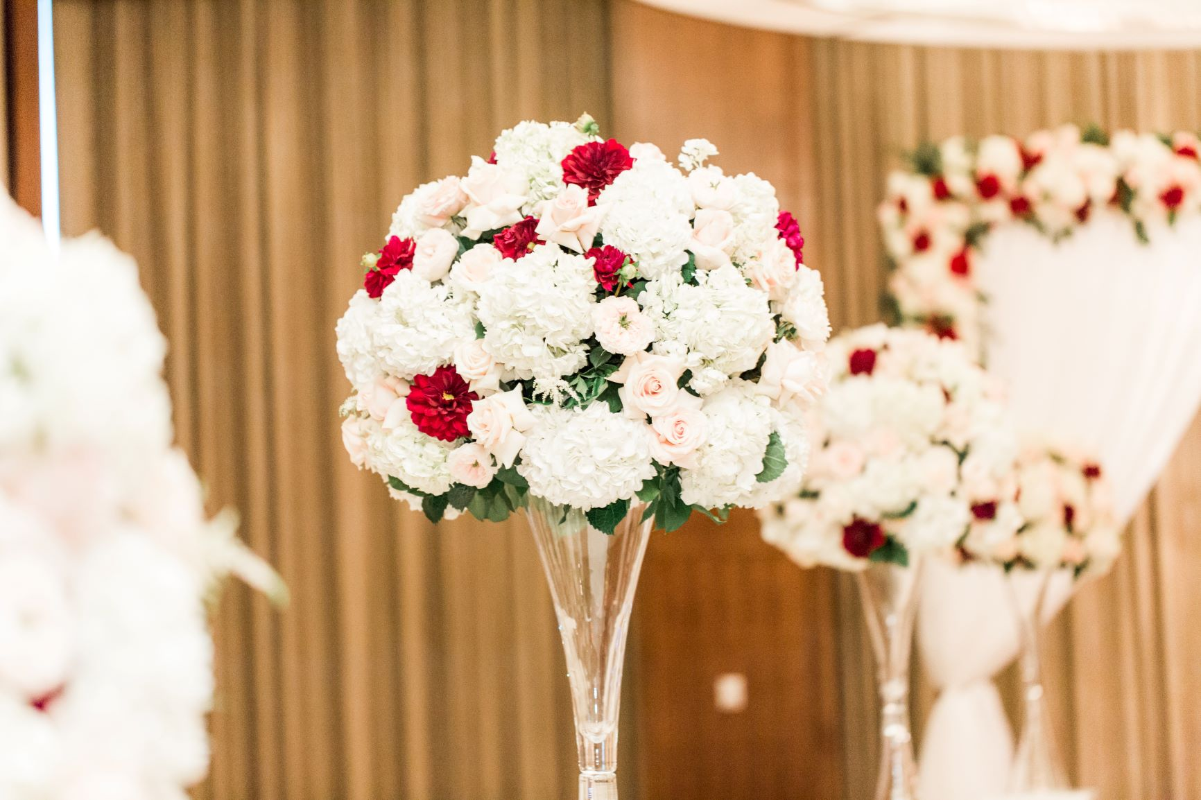 Bouquet style centerpiece with white and red flowers